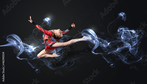 Fotobehang Dance School Young woman in gymnast suit posing
