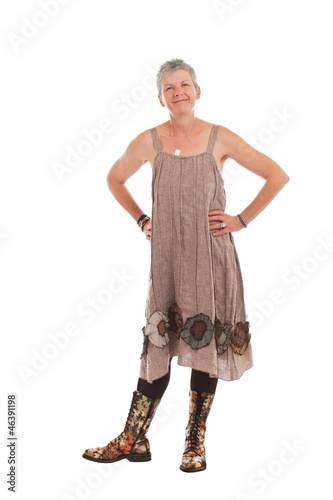 Happy older woman in flowered boots and dress