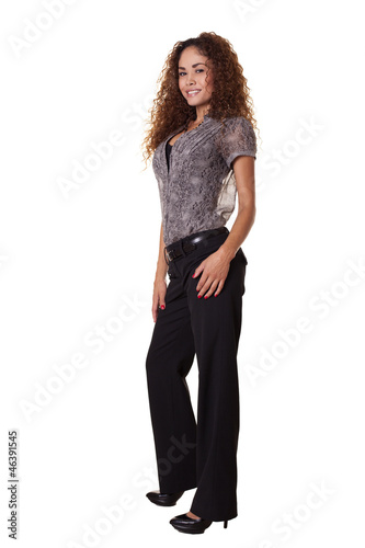 Woman standing in business clothes.
