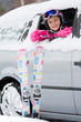 Winter travel - happy child on the road for ski holidays