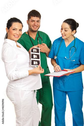 Happy doctors with pregnant woman