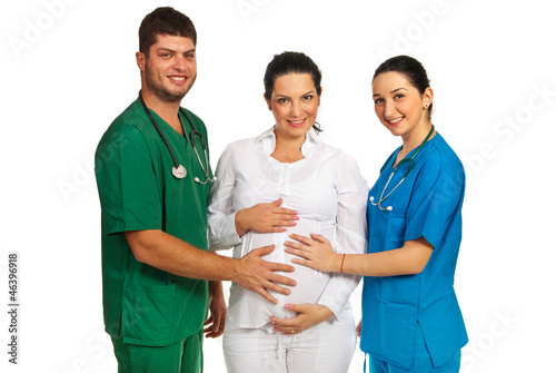 Doctors holding pregnant woman tummy