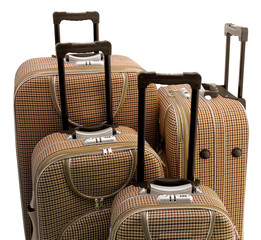 Four - travel suitcases (trolley) isolated