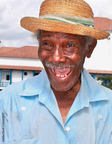 Old sympathetic cuban man with straw hat make a funny face, Cuba