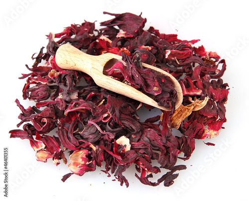 aromatic Hibiscus tea with wooden shovel, isolated on white