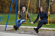young couple in the park on swing
