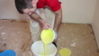 Painter Pouring Yellow Paint