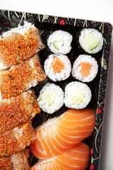 Close-up of sushi food on tray against white background