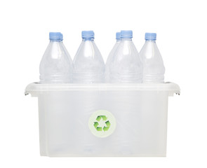 Group of plastic bottles in recycling bin over white background