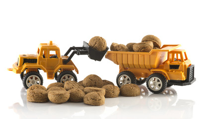 excavator filling truck with dutch pepernoten