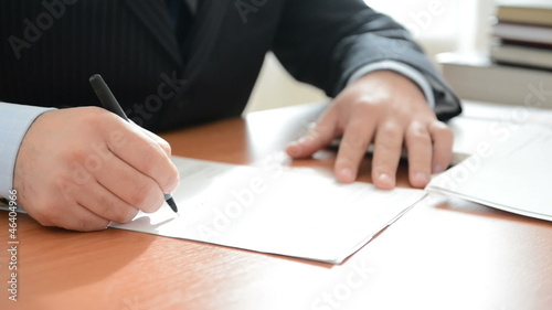 Businessman writing notes in a documents. Full HD
