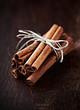 Cinnamon sticks on dark wooden background