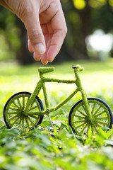 Hand Holding Eco Bicycle
