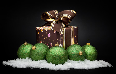 Green christmas balls with snow isolated on white bacground