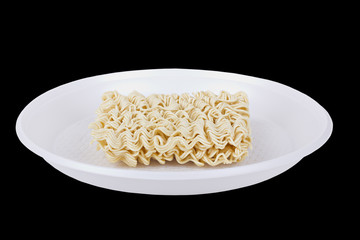 Dry noodles on the white disposable plate