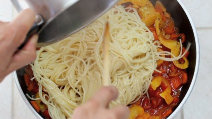 spaghetti with tomato sauce and yellow peppers