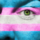 Transgender Flag painted on face  to show Transgender Pride supp