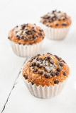 Chocolate chip muffins on white wood