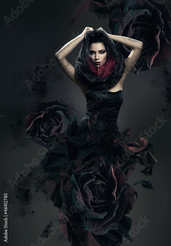 mysterious woman in dark hood and rose dress