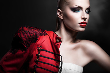 adult sexy blonde woman in red jacket with red lips