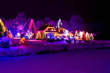 Christmas fantasy - park, forest & lodge in xmas lights