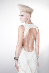 futuristic beautiful woman in dress with creative hairstyle