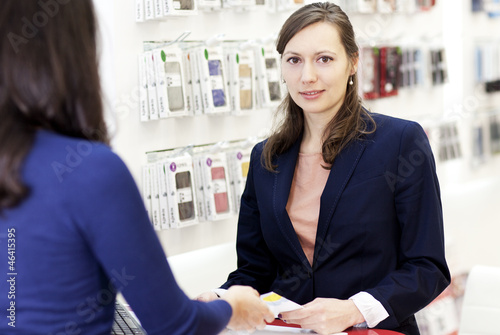 Woman working in a store with phones