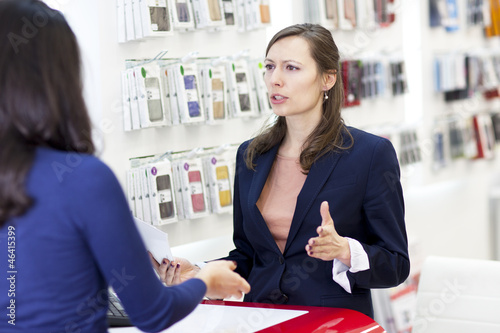 woman complaining in a electronics store