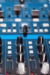 Control knobs on the console of a DJ deck