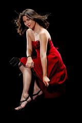 Beautiful woman keeping her dress down