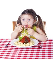 Girl shoving pasta in her mouth