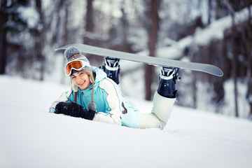 Young female snowboarder resting