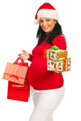 Pregnant woman with Christmas gifts