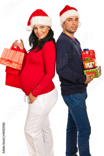 Happy couple holding Xmas gifts