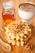 Healthy breakfast: waffles, nuts, honey and coffee