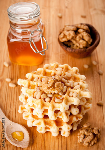 Healthy breakfast: waffles, nuts and honey