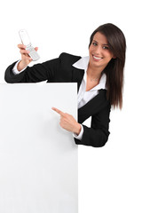 Businesswoman pointing at phone