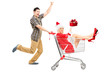 Excited man pushing a cart and woman in christmas costume