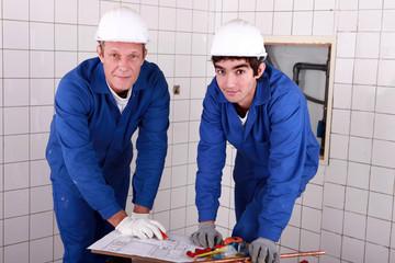 Two men do DIY