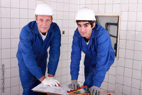 Two men do DIY