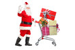 Santa Claus pushing a cart full of presents and waving hand