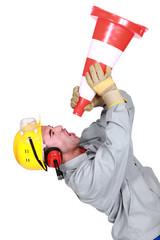 Angry tradesman yelling into a megaphone