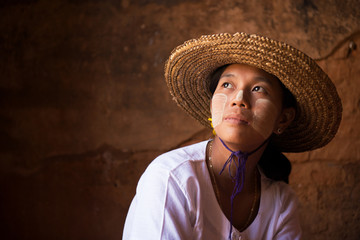 Myanmar girl in straw hot looking away