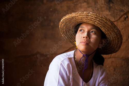 Myanmar girl in straw hot looking away