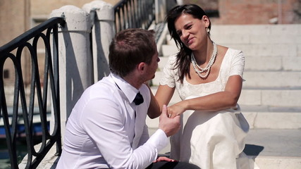 Just married happy couple on honeymoon in Venice, crane shot