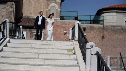 Just married couple on honeymoon in Venice, slow motion