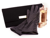 black clutch bag and leather gloves
