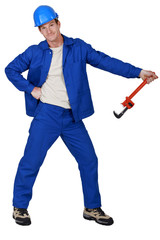 Goofy tradesman holding a pipe wrench