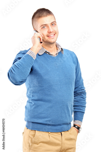 Smiling guy talking on a mobile phone