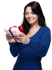 Young lady delighted to receive a gift - isolated